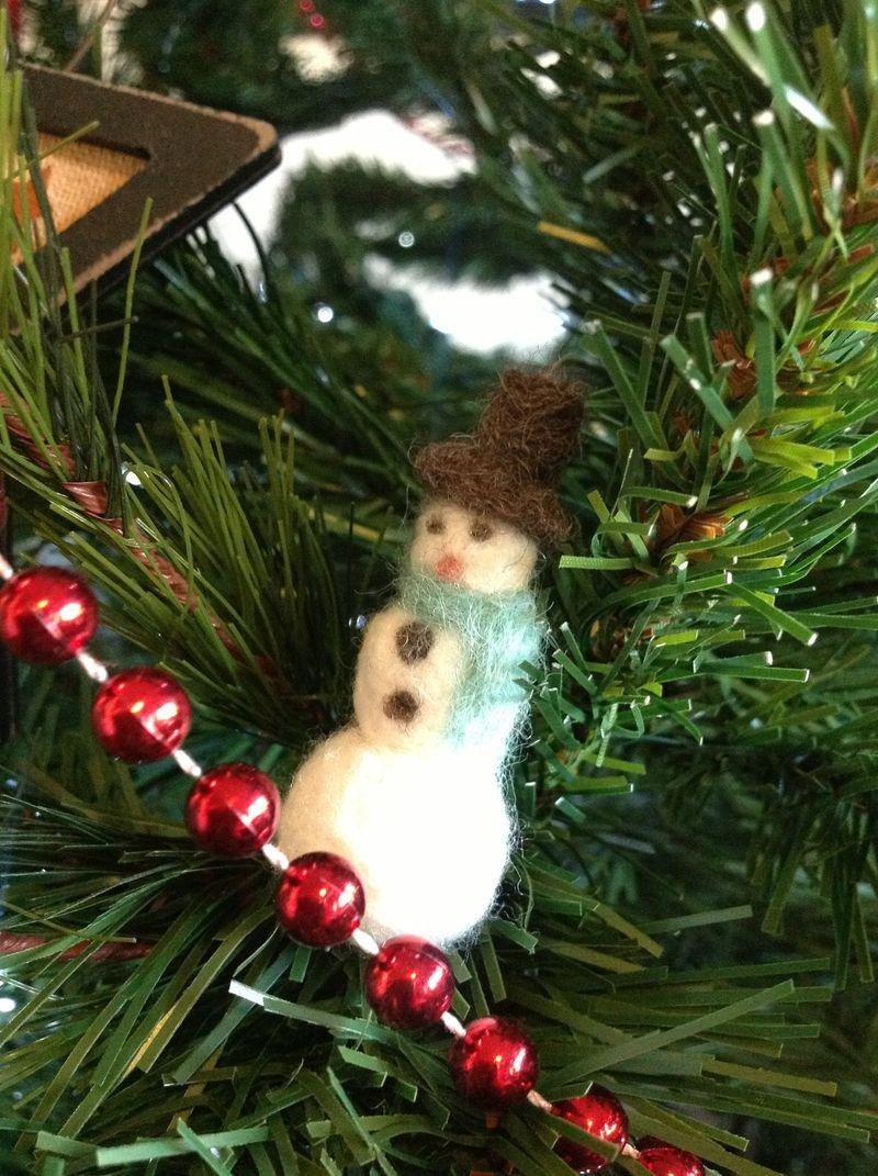 Tiny felted snowman